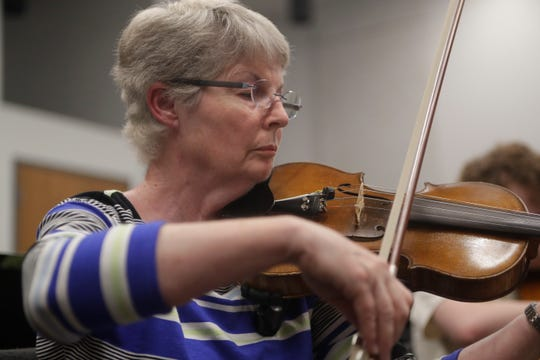 Violinist Judy Blancett plays during Big Bend Orchestra practice Thursday, April 11, 2019.