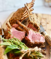 Garlic and thyme enhance the delicate  flavor of roasted lamb.