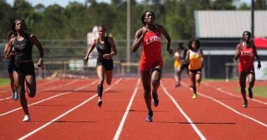 Leon sophomore Nadia Collins leads a 400 at the District 3-3A track and field meet at Chiles on Monday, April 15, 2019.