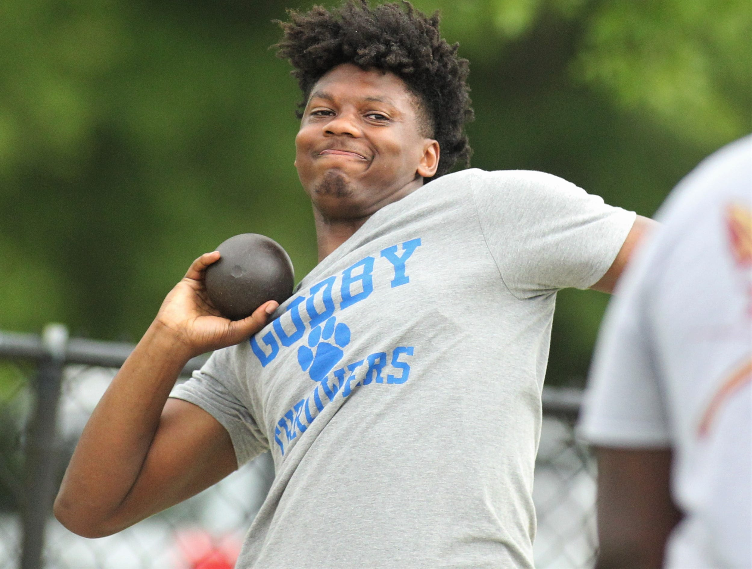 Godby's Kamari Young throws shot put during District 3-1A and 2-2A track and field meets at Florida High on Saturday, April 13, 2019.