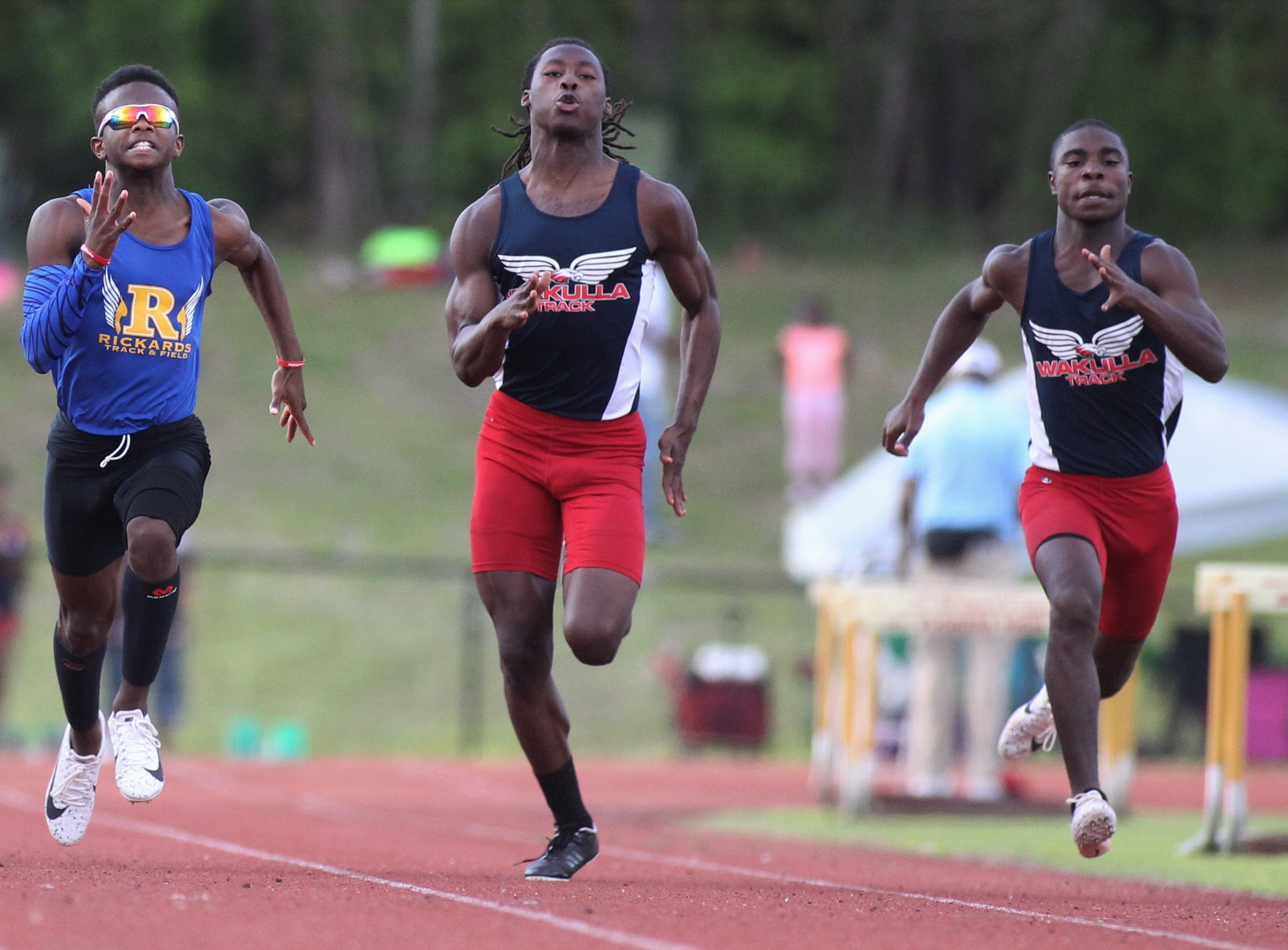 Wakulla's Jaylon Worsham (middle_ sprints the 100-meter dash during District 3-1A and 2-2A track and field meets at Florida High on Saturday, April 13, 2019.