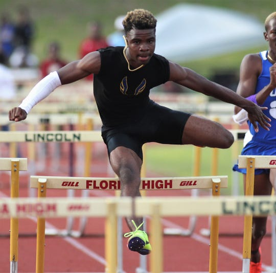 Rickards senior Jabari Bryant clears a hurdle during District 3-1A and 2-2A track and field meets at Florida High on Saturday, April 13, 2019.