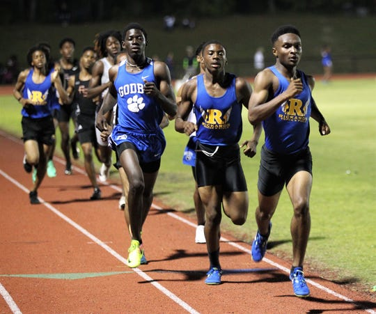Rickards' Jordan Guice leads in the 800m run as teammate Kolin Brown and Godby's Cornelius Barnes tail him during the District 2-2A track and field meet at Florida High on Saturday, April 13, 2019.