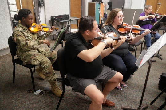 Jordan Marie Robinson, a Florida A&M student in ROTC, plays the violin during Big Bend Orchestra practice Thursday, April 11, 2019.