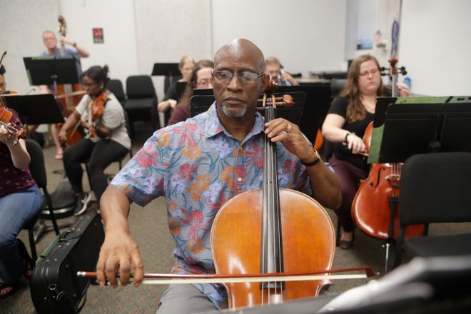 James Brown, cellist, plays during a practice for the Big Bend Orchestra at Tallahassee Community College Thursday, April 11, 2019.