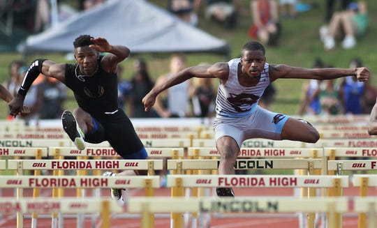 Rickards' Christopher Robinson races against Gadsden County's Alexander Gilliam in the 110-meter high hurdles during the District 2-2A track and field meet at Florida High on Saturday, April 13, 2019.