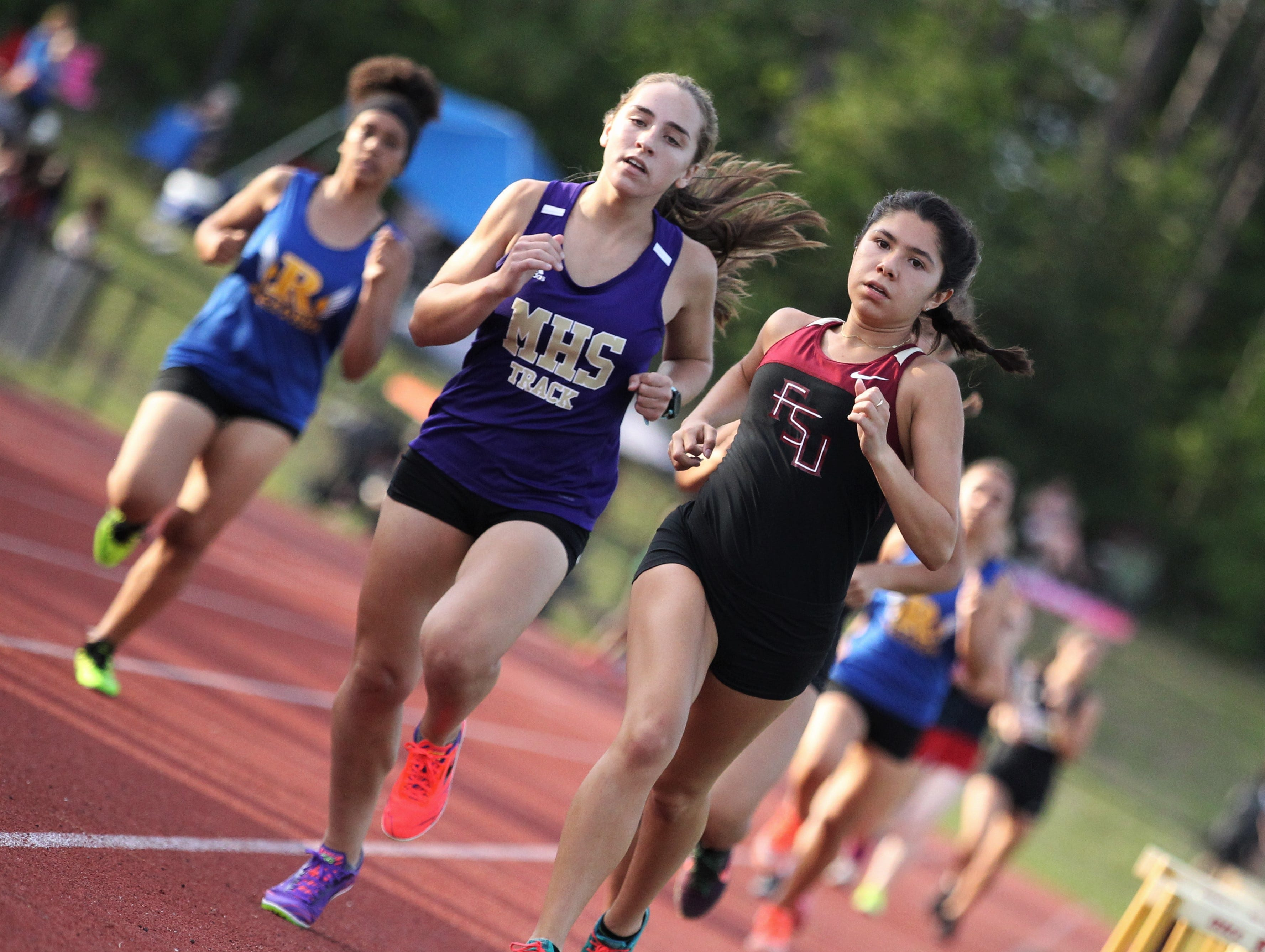 Florida High senior Summer Williams races during the District 3-1A and 2-2A track and field meets at Florida High on Saturday, April 13, 2019.
