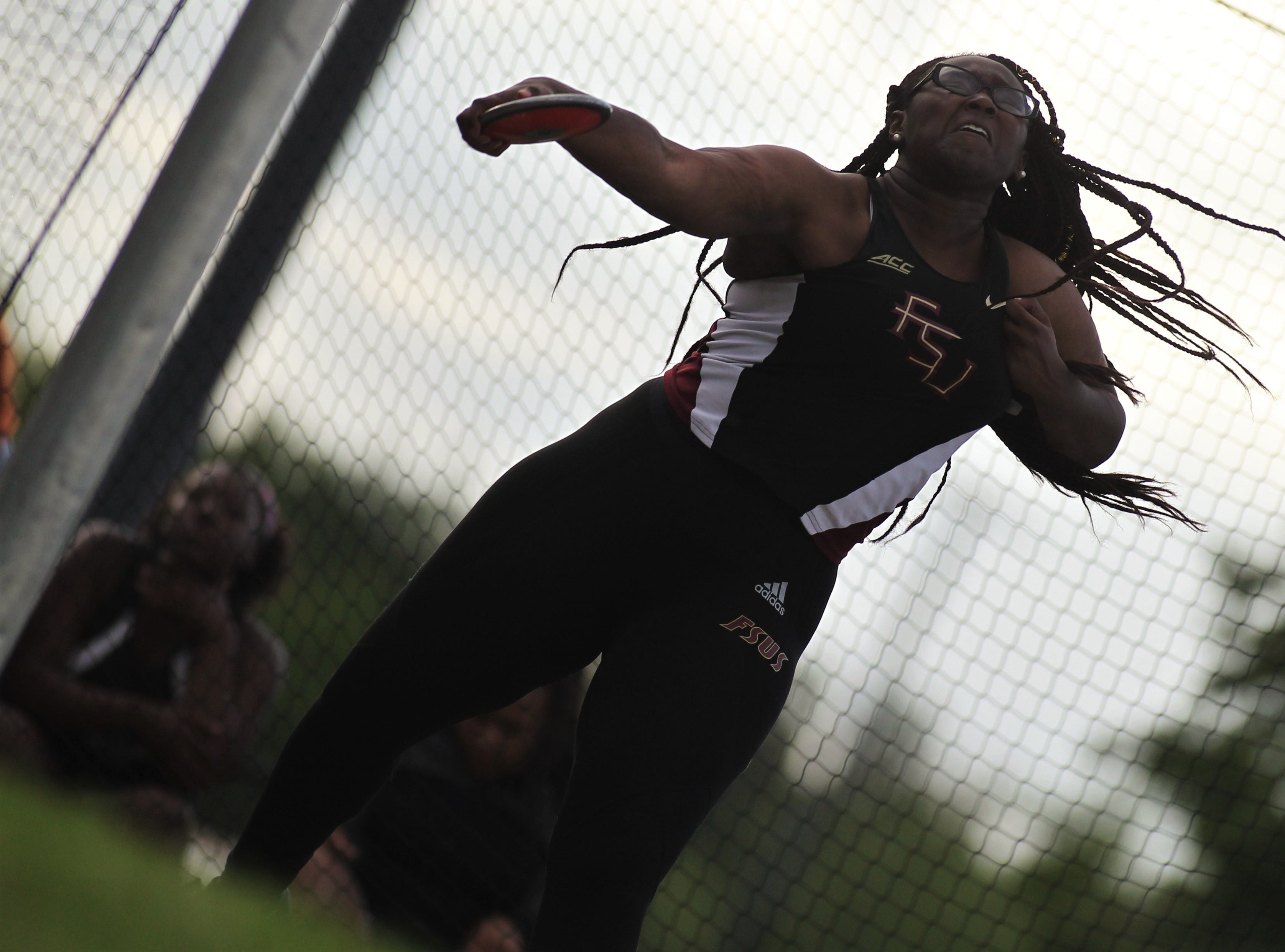 Florida High's Antonia Thomas throws discus during District 3-1A and 2-2A track and field meets at Florida High on Saturday, April 13, 2019.