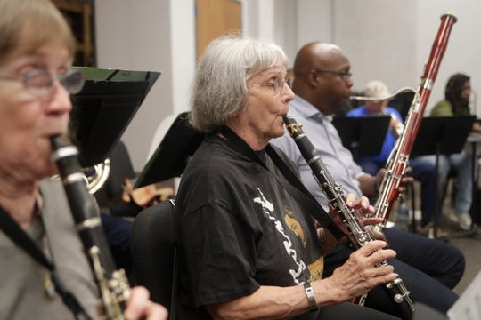 Ginny Dinsmore, one of the founders of the Big Bend Orchestra, plays the clarinet during practice at Tallahassee Community College Thursday, April 11, 2019.