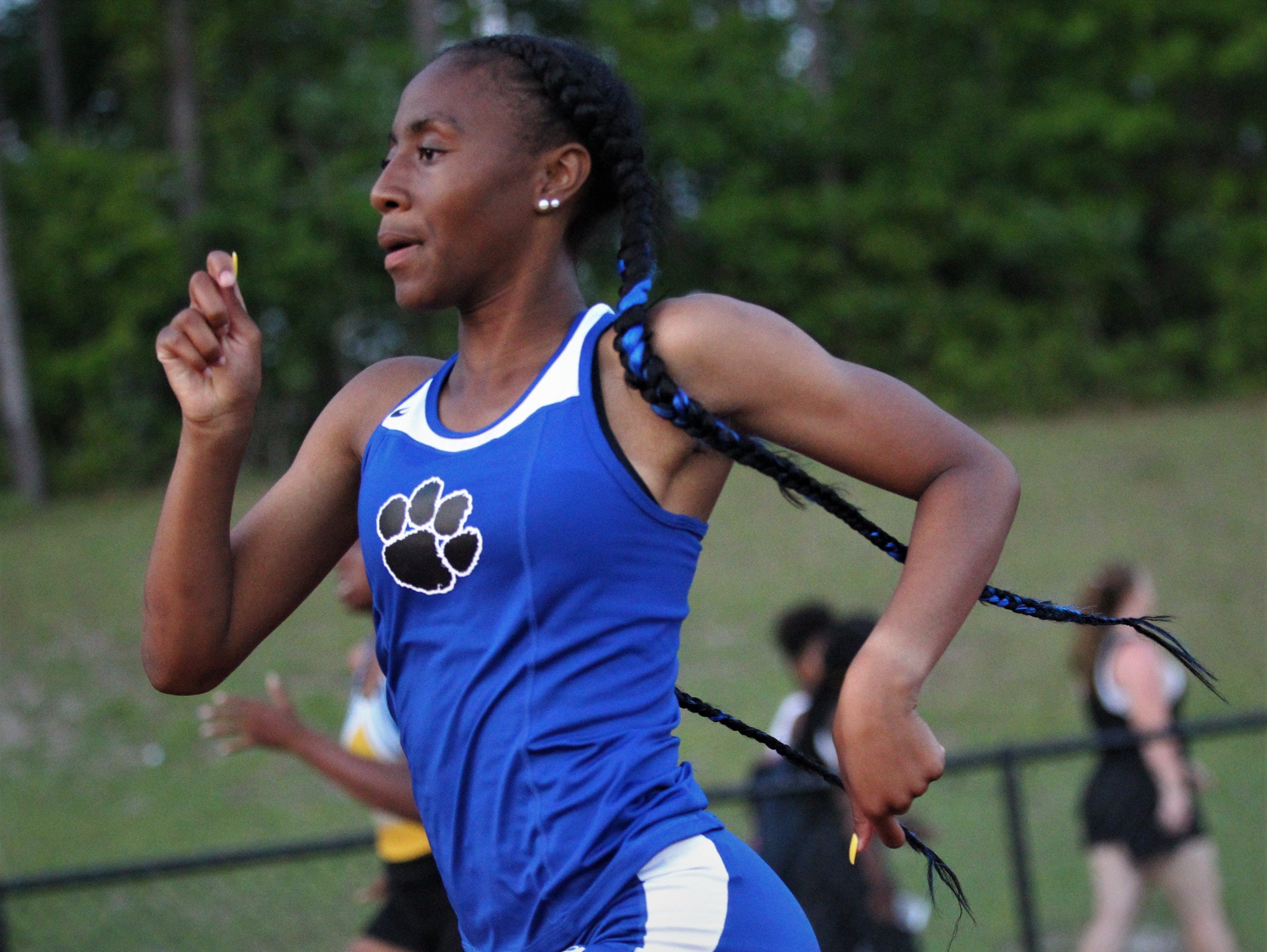 Godby junior A'Kyrah O'Banner races during the District 3-1A and 2-2A track and field meets at Florida High on Saturday, April 13, 2019.