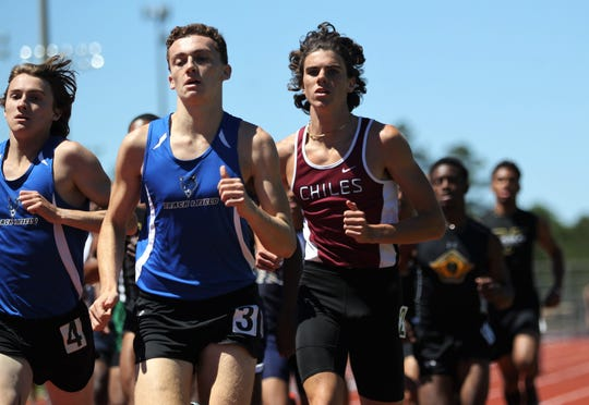 Chiles senior Connor Phillips runs the 800 at the District 3-3A track and field meet at Chiles on Monday, April 15, 2019.