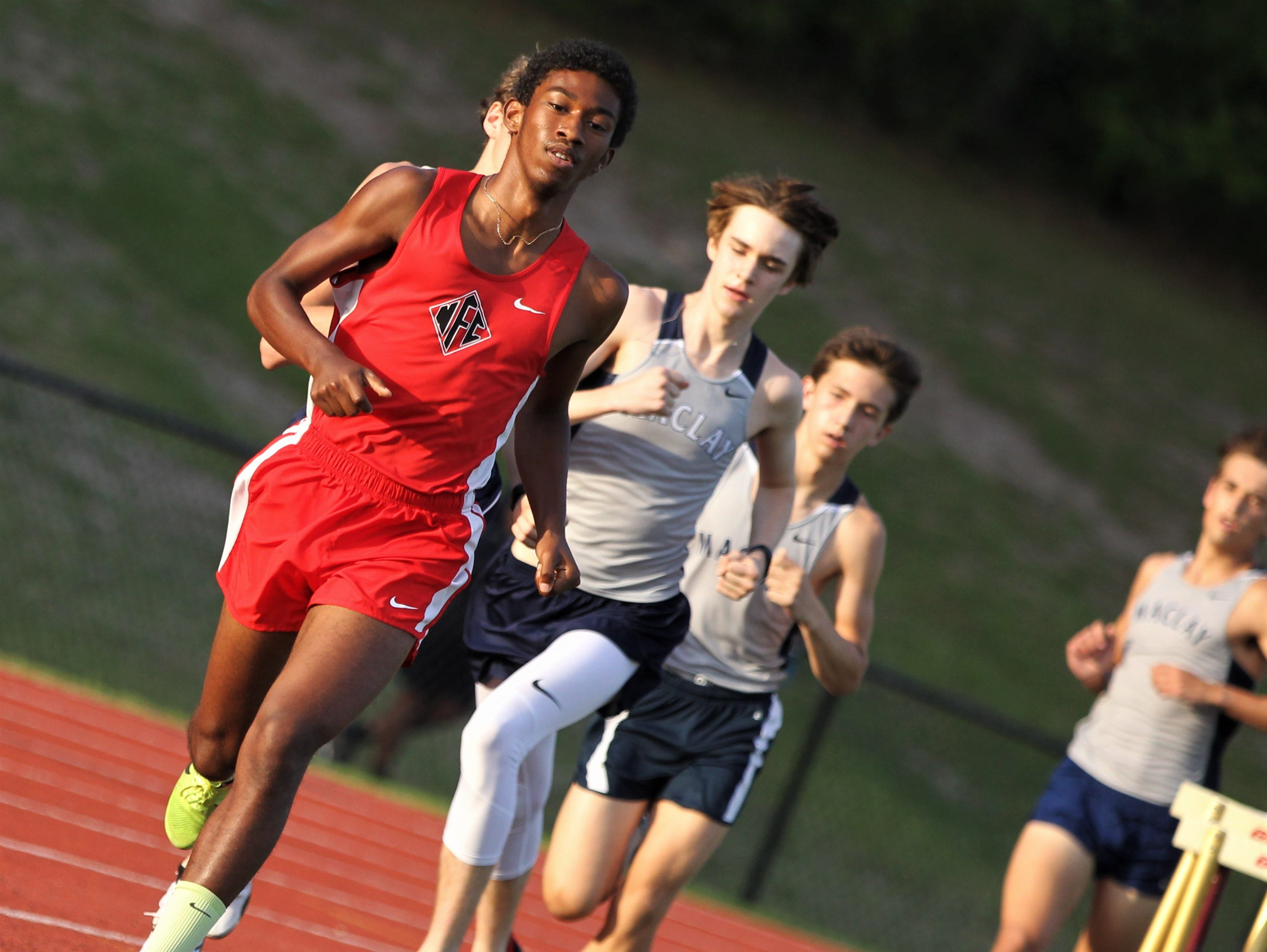NFC junior David Keen races during the District 3-1A and 2-2A track and field meets at Florida High on Saturday, April 13, 2019.