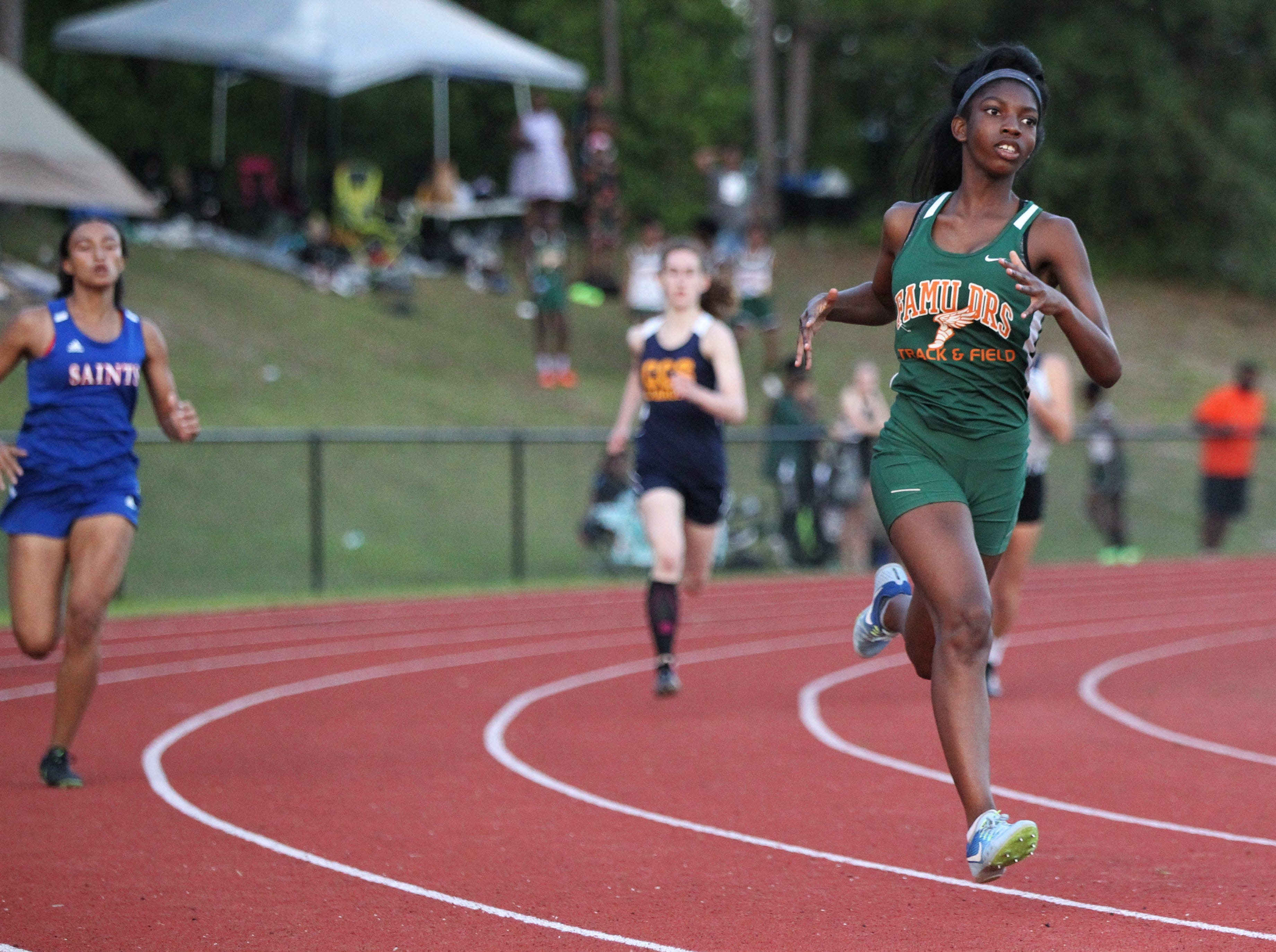 FAMU DRS sophomore Sanaa Crumiel races during the District 3-1A and 2-2A track and field meets at Florida High on Saturday, April 13, 2019.