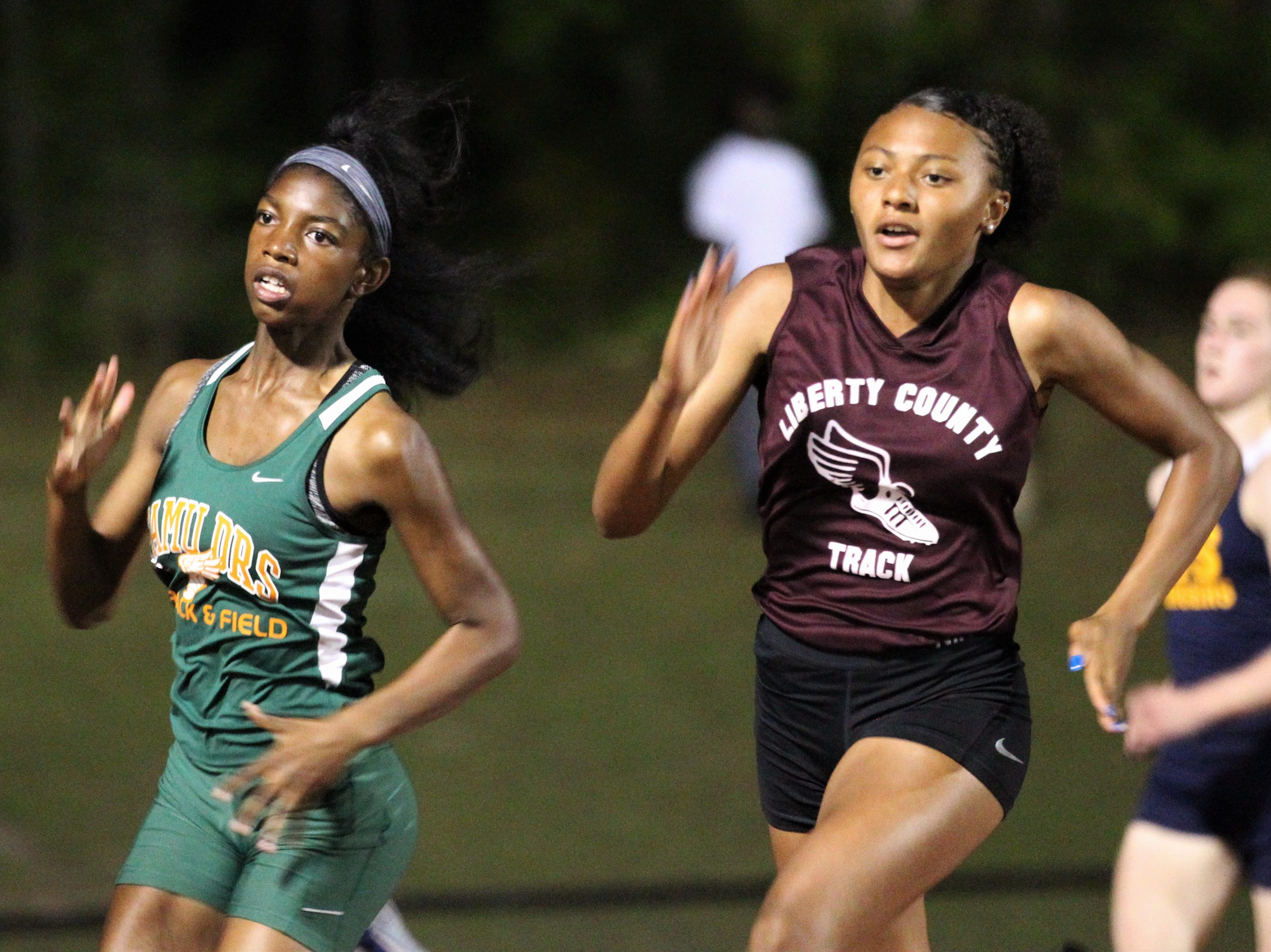 FAMU DRS sophomore Sanna Crumiel races during the District 3-1A and 2-2A track and field meets at Florida High on Saturday, April 13, 2019.