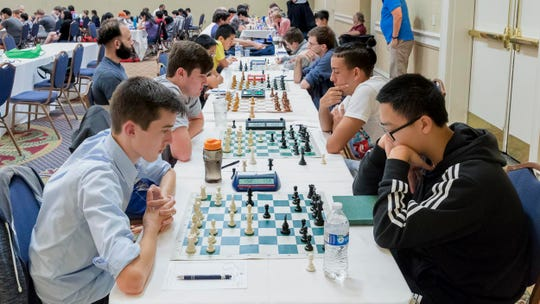 Ben Chiles (right) of Tallahassee competes in various chess tournaments throughout the nation. He currently is a USCF Candidate Master.