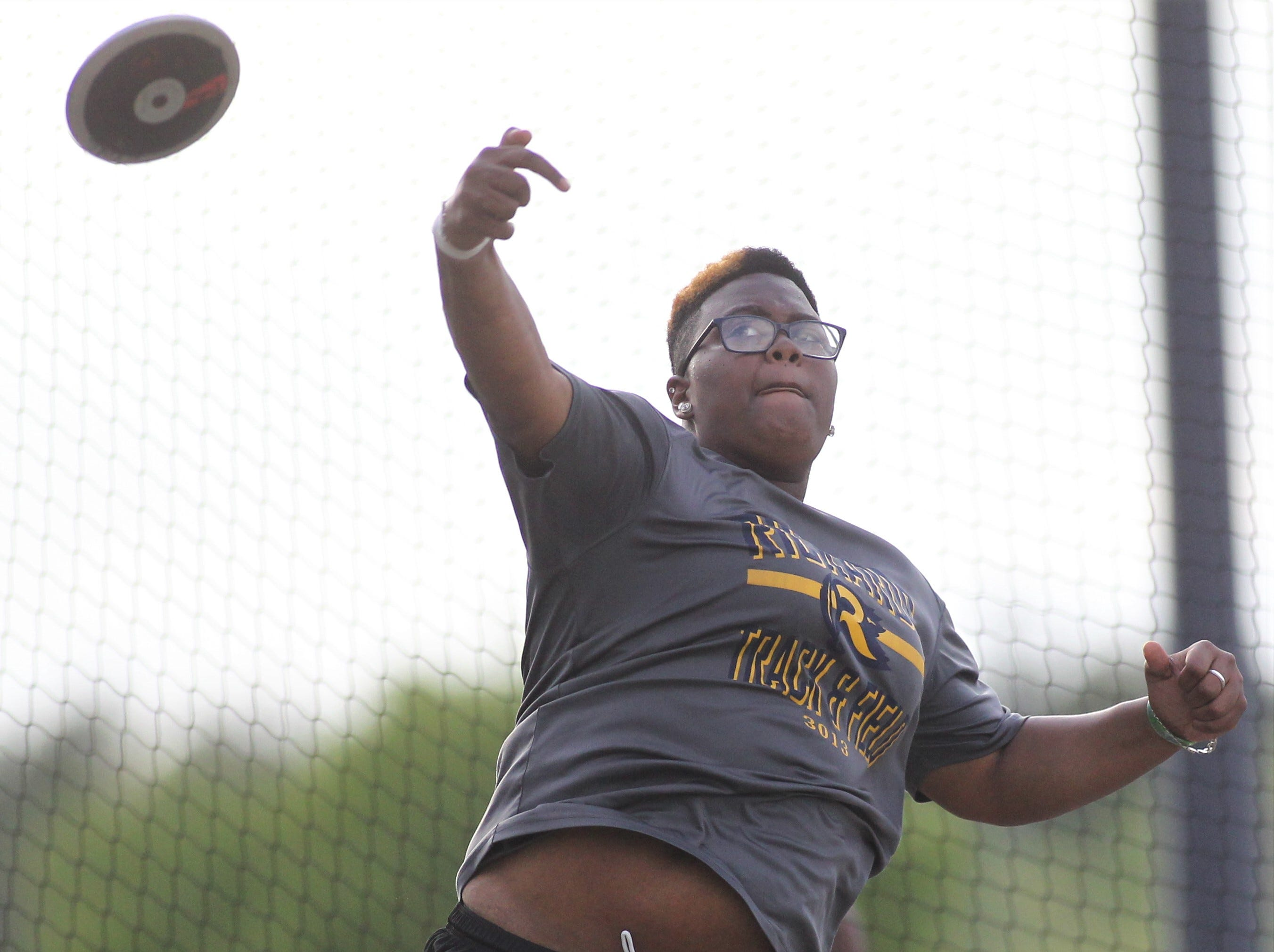 Rickards' Kantenesha Peters throws discus during District 3-1A and 2-2A track and field meets at Florida High on Saturday, April 13, 2019.