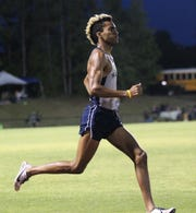 Maclay junior Jay Brown races during the District 3-1A and 2-2A track and field meets at Florida High on Saturday, April 13, 2019.