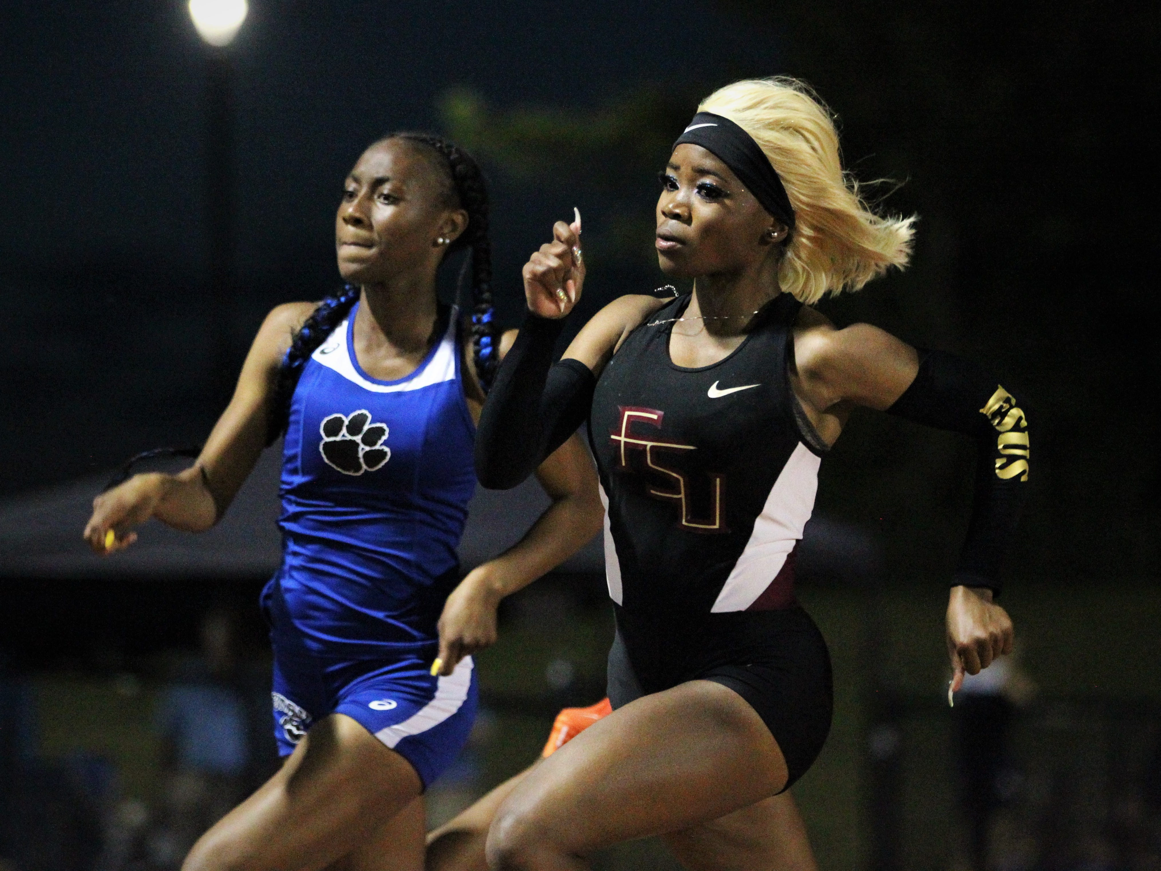 Florida High junior Jacquell Lewis races Godby junior A'Kyrah O'Banner in the 200 during the District 2-2A track and field meet at Florida High on Saturday, April 13, 2019.