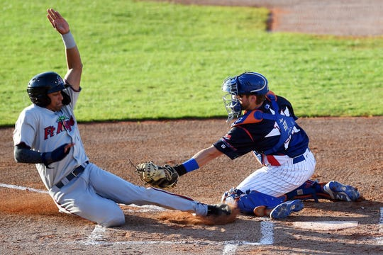 Fort Myers Miracle runner Royce Lewis is tagged out at the plate by St. Lucie Mets catcher Mitch Ghelfi in the top of the first inning on Monday, April 15, 2019 during the 6th annual Jackie Robinson Celebration Game at Holman Stadium at the Jackie Robinson Training Complex in Vero Beach. Proceeds of the game went to benefit the United Way of Indian River County.