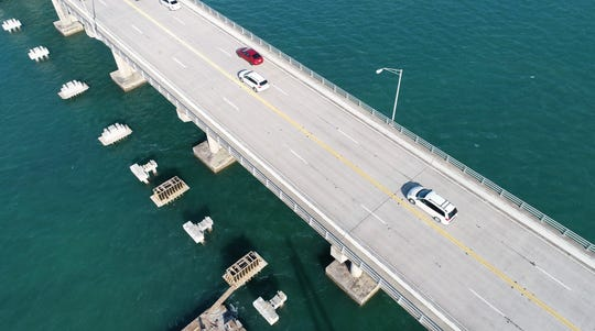An aerial view of South Bridge in Fort Pierce. There is a plan to reduce the current four lanes to two, and widen those lanes from 10 feet to 12 feet. The remainingspace would be re-stripedfor bicycle lanes,disabled vehicles and emergency vehicles.