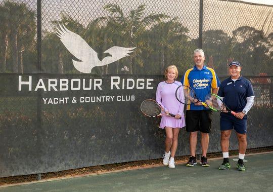 Peggy Austin, Harbour Ridge Tennis Committee; Robert Wesch, Rotary Tennis Committee; and Fabio Vasconcellos, Harbour Ridge tennis professional.