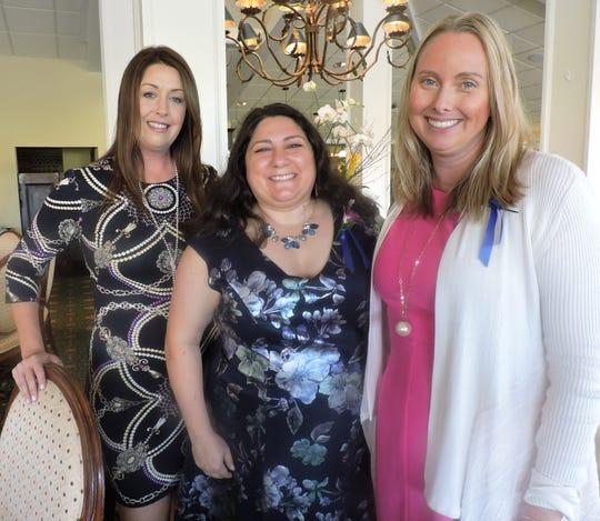 Jennifer Ahern, left, Lisa Compagno, 2017 Business/Professional winner, and Kim Waser Nash, nominee for Volunteer Category, at Soroptimist International of Stuart's Women of Distinction Awards Dinner.