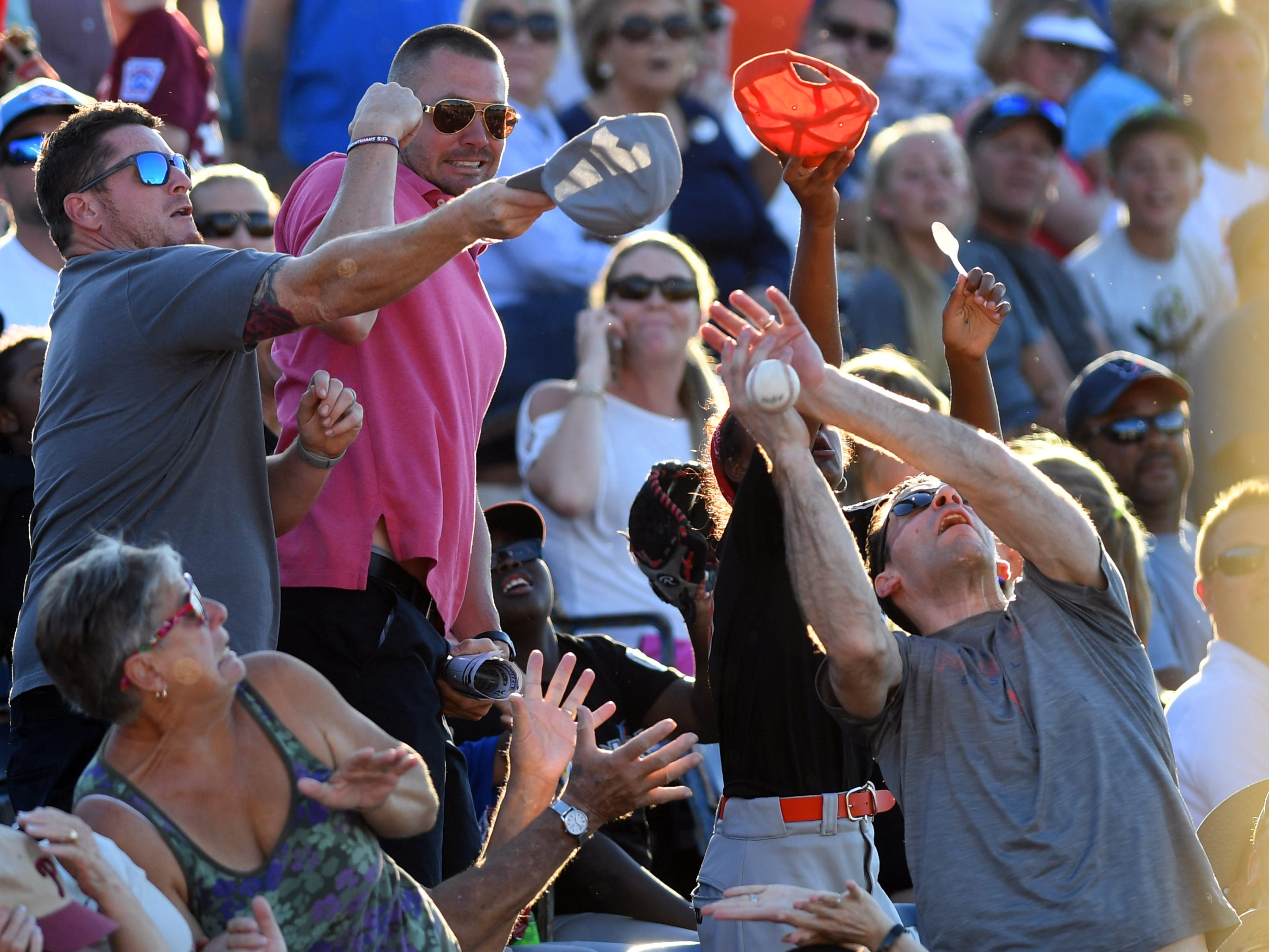 Spectators try their luck at catching a foul ball on Monday, April 15, 2019 during the 6th annual Jackie Robinson Celebration Game at Holman Field at the Jackie Robinson Training Complex in Vero Beach. Proceeds of the sold out game between the St. Lucie Mets and Fort Myers Miracle went to benefit the United Way of Indian River County.