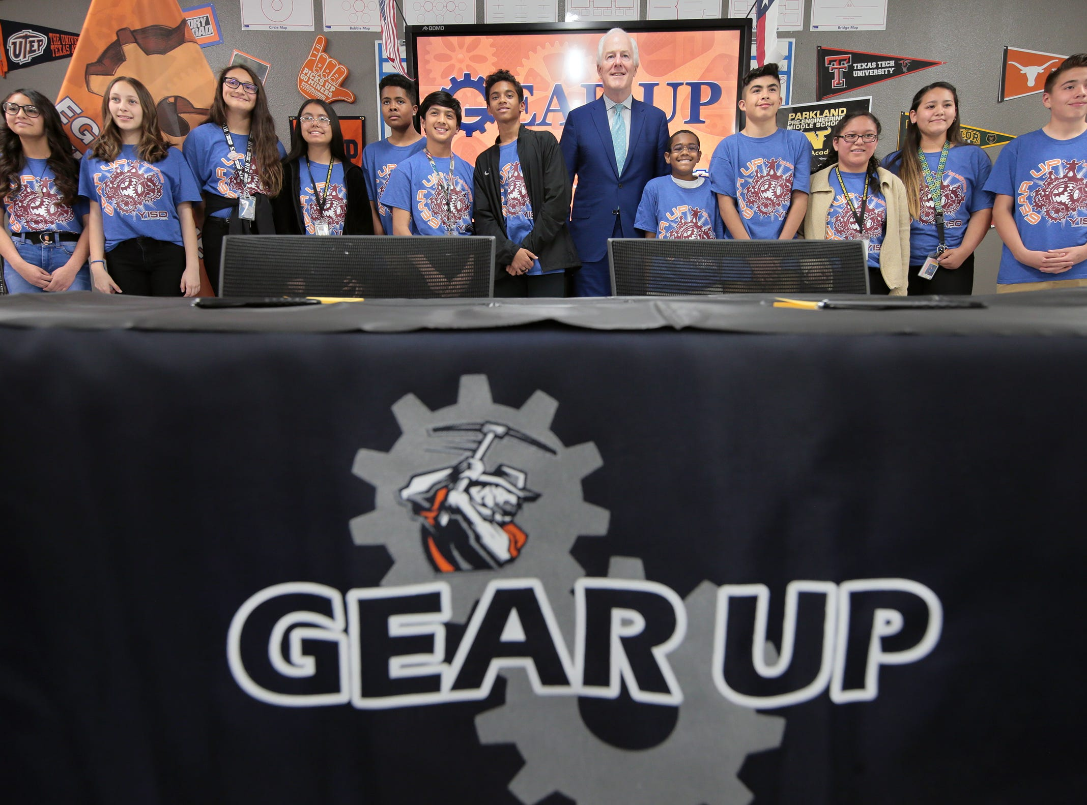 U.S. Sen. John Cornyn poses for a photo with Parkland Middle School seventh graders Tuesday after a roundtable to discuss the benefits of the Gear Up Act.