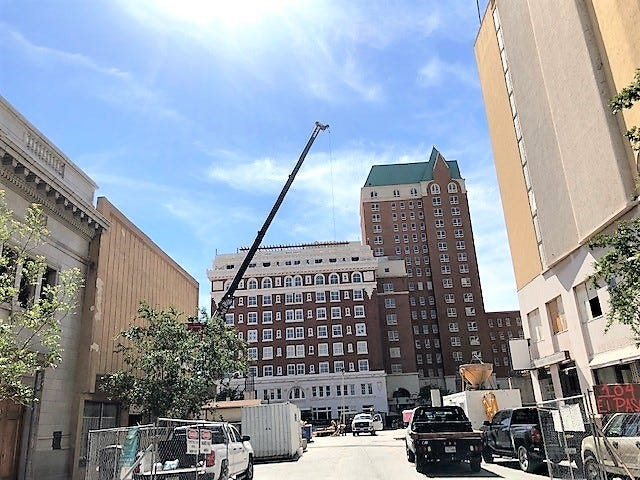 A crane hovers over the area where a parking garage is being built along San Antonio Ave., and South El Paso Street. Part of the garage will block this view of the historic Hotel Paso Del Norte.