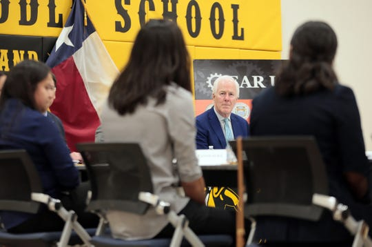 U.S. Sen. John Cornyn on Tuesday, April 16, 2019, listens to high school students who have benefited from the Gear Up Program.