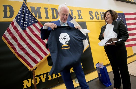 U.S. Sen. John Cornyn, R-Texas, opens a gift honoring UTEP President Diana Natalicio after holding a pair of roundtables with students and educators at Parkland Middle School on Tuesday, April 16, 2019. Cornyn visited the school to learn about the impact of the Gear Up program on students. Cornyn is working on a bipartisan bill, The Gear Up for Success Act, which will make improvements to the existing program. Currently, the bill requires school districts to match grant dollars, which Cornyn said can be burdensome on their budgets. He hopes to reduce the percentage of matching dollars from 100% to 50% to make it more accessible to schools. The Gear Up Program, among other things, pairs middle school students with UTEP students who act as educational mentors.