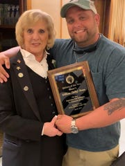 """Arleen Hickman, Exalted Ruler, Millville Elks Lodge No. 580, presents the Citizen of the Year Award to William """"Billy"""" Green."""