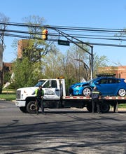 A tow service removes a car involved in a collision with a school bus from Chestnut Avenue, near State Street, in Vineland. April 16, 2019