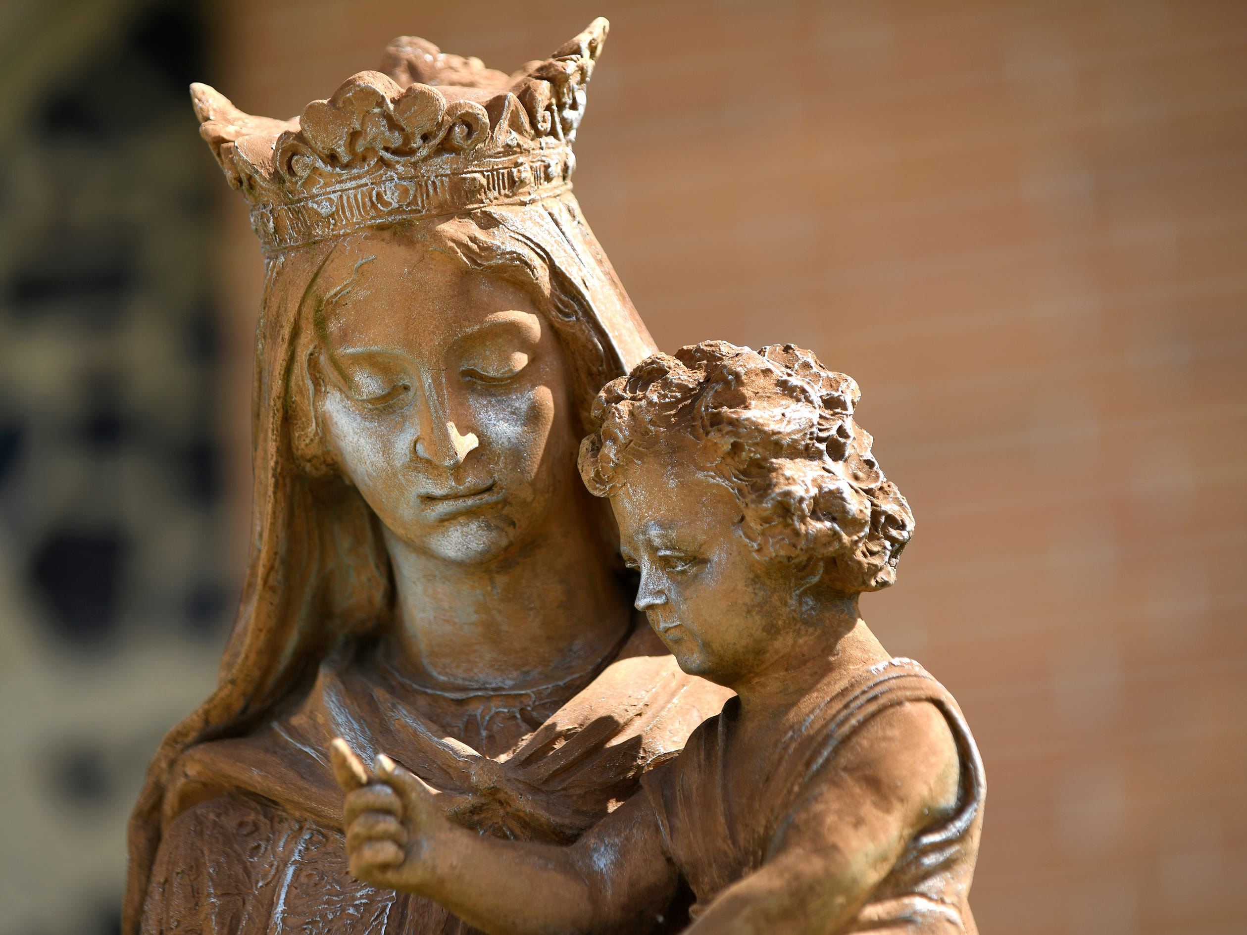 """Our Lady of Pompeii"" Queen of the Rosary stands outside the church. The statue reads ""In loving memory of Dorothy Anna Ferrari."""