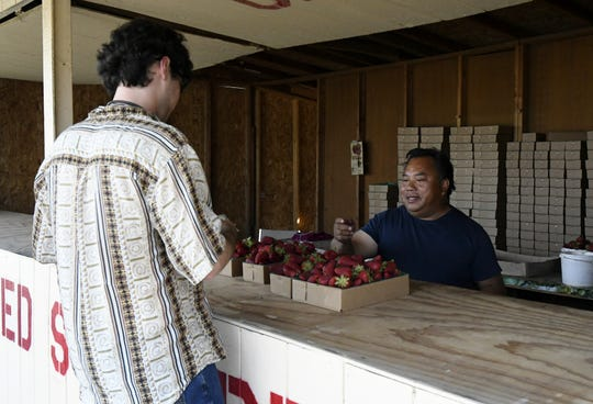 Strawberry farmer Jim Kay Chao sells a pallet of strawberries at his stand on Visalia Parkway on Monday, April 15, 2019.