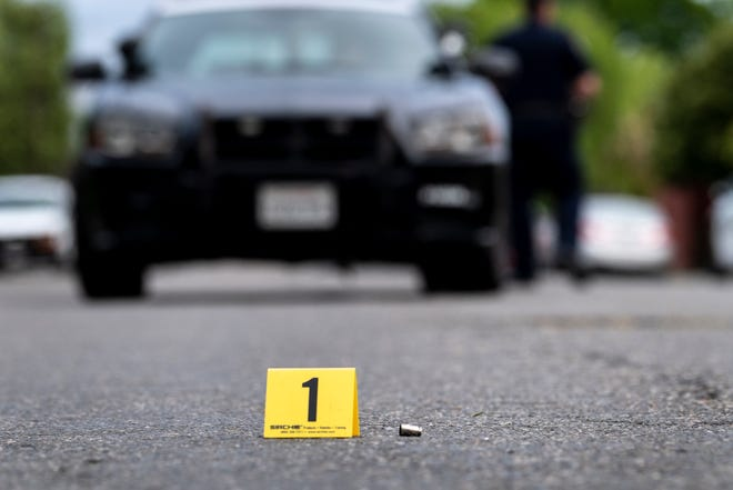 Visalia Police investigate a drive-by shooting near Park Street and Oak Avenue on Monday, April 15, 2019. Witnesses reported 3 to 4 shots, no injuries were reported. Shell casings were found at the scene.