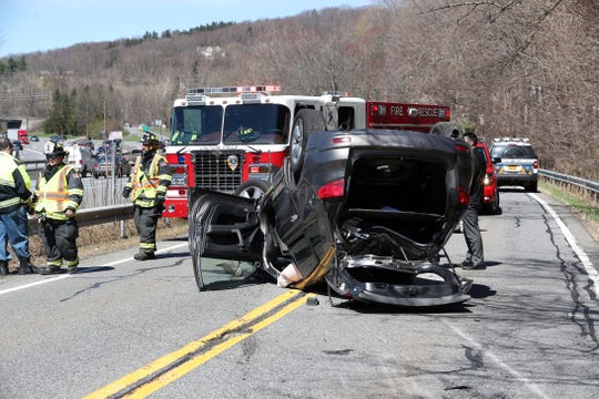 Croton Falls firefighters on the scene of a car that rolled over from northbound I-684 onto Route 22 in Purdys April 16,  2019. The driver of the car was transported to Danbury Hospital by North Salem Ambulance Corps.