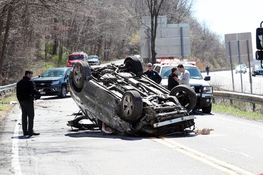 State police work at the scene of a car that rolled over from northbound I-684 onto Route 22 in Purdys April 16,  2019. The driver of the car was transported to Danbury Hospital by North Salem Ambulance Corps.