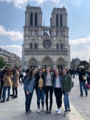 Eastchester High School students on tour in Paris this week include, from left: Catherine Dwyer, Lauren Naclerio, Emily Johnson and Patricia Murtagh. The students and their chaperones visited Notre Dame Cathedral on Palm Sunday, April 14, 2019, the day before a devastating fire. The 14 students and chaperones could see smoke from the cathedral fire from their hotel near the Eiffel Tower.