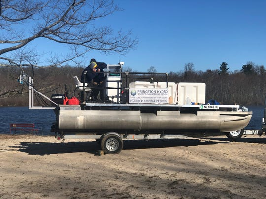 A barge from which alum will be applied to Lake Mohegan in Yorktown to treat it as part of a program to battle harmful algae growth.