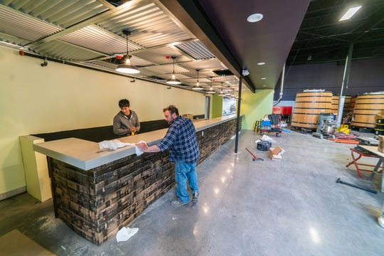 Putting the finishing touches on the bar at the expanded space at Captain Lawrence in Elmsford.
