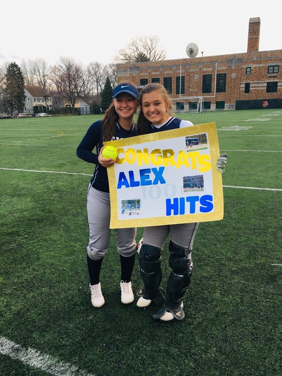 Putnam Valley twins Keiko (left) and Alex Waters (right) celebrate after Alex's 100th career hit on Apr. 8, 2019.