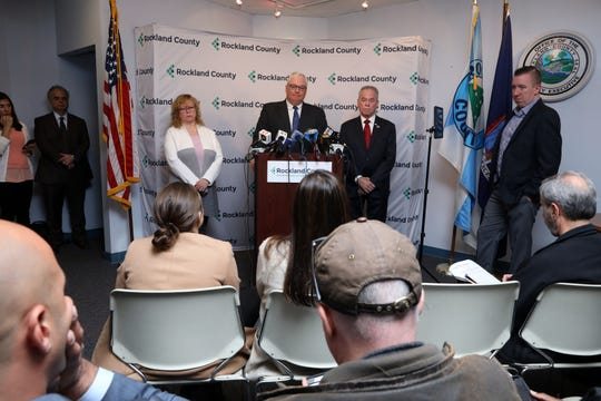 Commissioner of Health Dr. Patricia Schnabel Ruppert, left, Attorney Thomas Humbach and County Executive Ed Day discuss new measles exclusion order that mandates anyone with measles to stay home, and those exposed stay out of public spaces throughout Rockland county, April 16, 2019 in New City.
