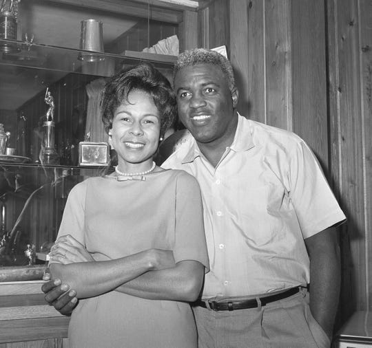 Jackie Robinson and his wife, Rachel, pose in their Stamford, CT , home January 23, 1962, after Jackie's election into The Baseball Hall Of Fame. Robinson, the former Brooklyn Dodger infielder, had a lifetime batting average of .311. He was the first black player to play in the Major Leagues, and also the first black player to be voted into the Hall Of Fame. ( AP Photo/ Matty Zimmerman )