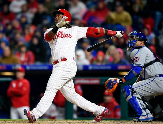 Maikel Franco watches the ball in front of New York Mets catcher Wilson Ramos after hitting a two-run home run off Noah Syndergaard during the fourth inning Monday at Citizens Bank Park.