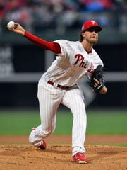 Philadelphia Phillies starting pitcher Aaron Nola throws during the first inning against the New York Mets, Monday.