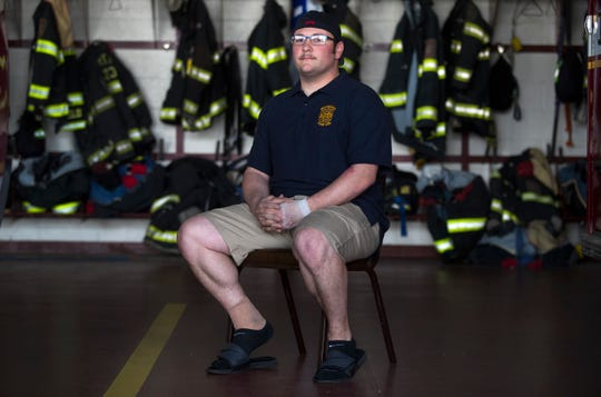 Minquas Fire Company Firefighter Dave Smiley sits for a portrait at Station 23 in Newport. Smiley received second- and third-degree burns to 10 percent of his body after he became trapped inside a burning home in Mill Creek last month.
