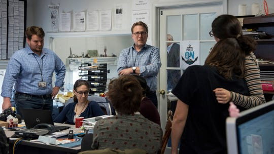 "Editor Rick Hutzell, center, gives a speech to his staff including Chase Cook, Nicki Catterlin, Rachael Pacella, Selene San Felice and Danielle Ohl at the Capital Gazette in Annapolis, Md., Monday, April 15, 2019. Hutzell said Monday that his staff experienced some ""rollercoaster moments"" as it won a special Pulitzer Prize citation for its coverage and courage in the face of a massacre in its own newsroom. ""Clearly, there were a lot of mixed feelings,"" Hutzell told The Associated Press. ""No one wants to win an award for something that kills five of your friends."" (Ulysses Muoz/The Baltimore Sun via AP)"