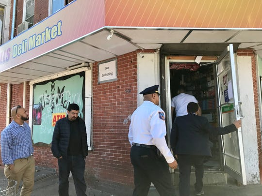Police Capt. Anthony Bowers inspects Bill's Deli Market before it is allowed to reopen.