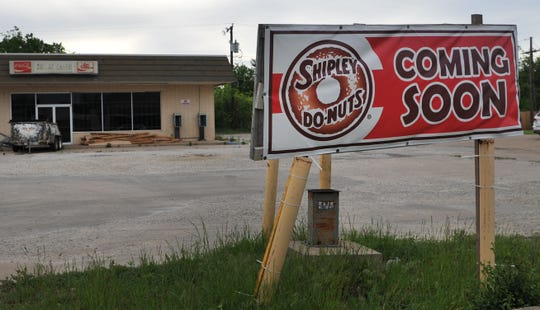"""A sign outside of an old convenience store located on Kemp Blvd., reads """"Shipley Do-Nuts coming soon."""""""